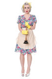 Sad fifties housewife with sink plunger, humorous concept, isolated on white royalty free stock image