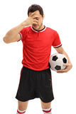 Sad football player holding his head in disbelief Royalty Free Stock Photography