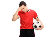 Sad football player looking down Royalty Free Stock Images