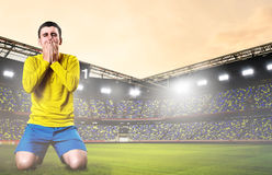 SAD fotboll för spelare royaltyfri bild