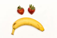 The Sad Fruit. Strawberries and banana forming a sad face Royalty Free Stock Images