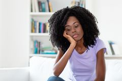 Sad and frustrated african american woman. Indoors at home royalty free stock photography