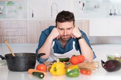 Sad and frustrated man with kitchen fails royalty free stock photos