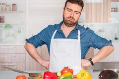 Sad and frustrated man with problem in the kitchen royalty free stock photography