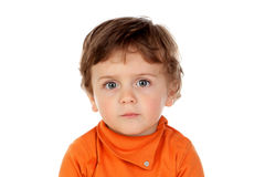 Sad funny baby with orange jersey Royalty Free Stock Image