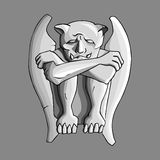 Sad gargoyle stone sculpture Stock Photo