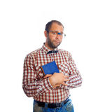 Sad geek guy with book looking at camera Royalty Free Stock Photos