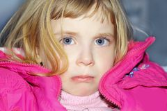 Sad gesture in blond little girl portrait Royalty Free Stock Photography