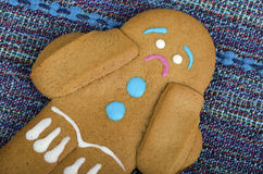 Sad gingerbread man on a table Stock Images