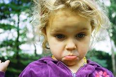 Sad girl. Little girl looking very upset and sad Stock Image