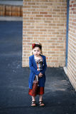 Sad girl. Preschool age girl standing alone in urban setting Stock Photo
