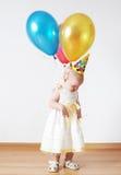 Sad girl. In birthday cap with balloons Stock Photos