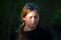 Sad girl. Portrait of a sad girl lit by sun stock photos