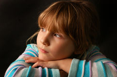 Sad girl. Portrait of sad  little girl in studio on black background Royalty Free Stock Photo