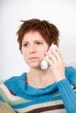 Sad girl. Cute sad girl on the white phone Stock Photos