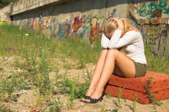 Sad girl. Crying outdoors with graffiti background royalty free stock photos
