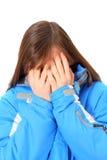 Sad girl. Sad teenage girl isolated on the white Stock Photo