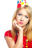 Sad girl. At a party on white background Royalty Free Stock Photography