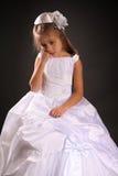 Sad girl. Cute little girl on dark background Royalty Free Stock Image
