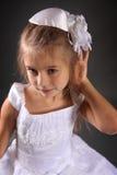 Sad girl. Cute little girl on dark background Stock Photography