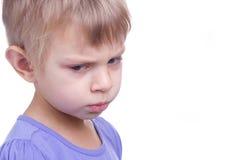 Sad girl. Little blonde girl with sad eyes on white background Stock Photos
