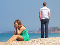 Sad girl. On the beach. Relationships and feelings Royalty Free Stock Photography