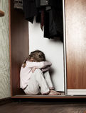Sad girl. Depressed child at home. Problems at family Royalty Free Stock Photos