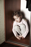 Sad girl. Depressed child at home. Problems at family Stock Photo