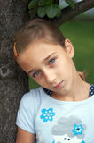 Sad girl. Under the tree Royalty Free Stock Images