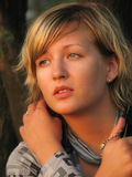 Sad girl. Young beautiful woman looking ahead Stock Photo