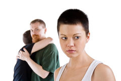 The sad girl against embracing couple. The frustration girl against embracing couple Stock Images