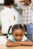 Sad girl against parents arguing Stock Photos
