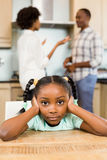 Sad girl against parents arguing Stock Image