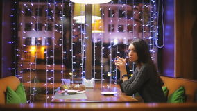 Sad girl alone in a cafe. stock footage