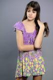 Sad Girl Arranging Black Hair Stock Photography