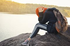Sad girl backpack in nature winter season stock images