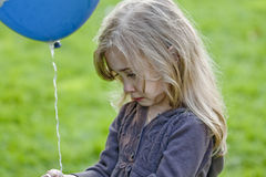 Sad girl with balloon Stock Photo