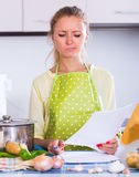 Sad girl with banking statement at home Stock Photography