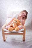 Sad girl with bear Royalty Free Stock Photo