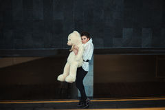 Sad girl with a bear. Royalty Free Stock Images