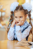 Sad girl with beautiful bows Royalty Free Stock Images