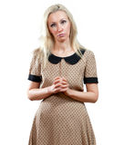 The sad girl in a beige dress Royalty Free Stock Photography