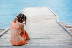 Sad girl on berth Royalty Free Stock Photography