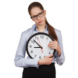 Sad girl with a big clock Stock Photos