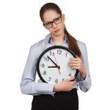 Sad girl with a big clock. In hands Stock Photos