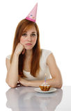 Sad girl with birthday cake Royalty Free Stock Photo