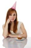 Sad girl with birthday cake. On white background Royalty Free Stock Photo
