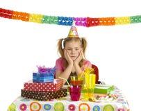 Sad girl on birthday party Stock Photography
