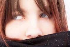 Sad girl in a black headscarf Stock Image