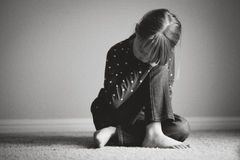Sad girl. Black and white image of a girl who seems sad royalty free stock photos